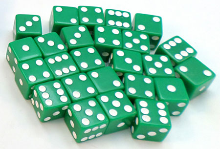 Twenty-five green dice on a table