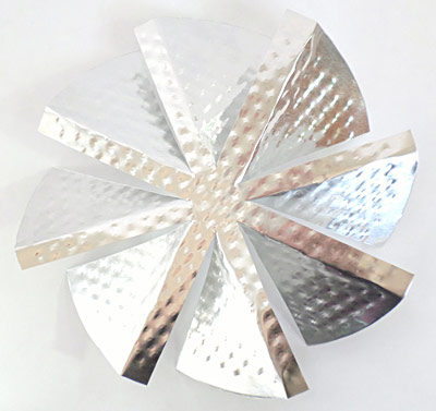 A windmill with angled blades made from the bottom of an aluminum pie pan