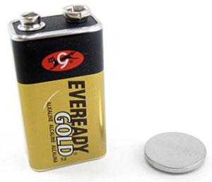 A nine volt battery next to a coin cell battery
