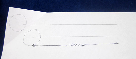 A circle with a line drawn outward from its center is drawn twice on a piece of paper