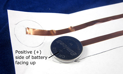 Paper circuit coin cell battery