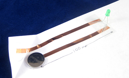 A paper circuit made from a battery, copper tape and an LED