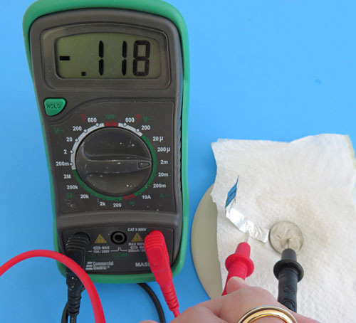 Measure the current produce by your coin battery with a multimeter.
