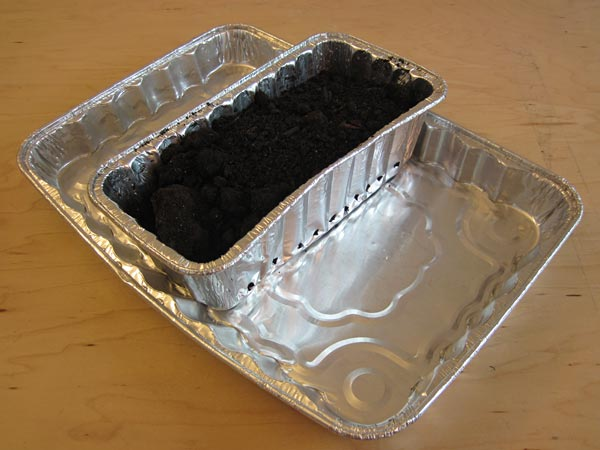 Soil in bread pan in cake pan