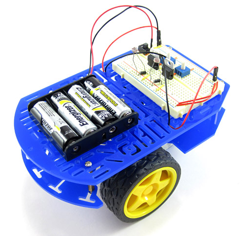 An assembled chassis with a breadboard and battery pack for a light-following robot