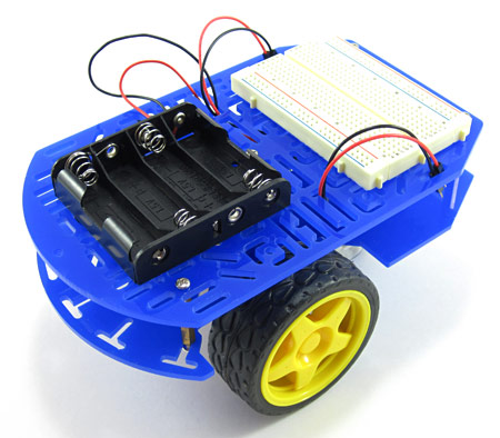 An assembled chassis with a breadboard and battery pack for a line-following robot