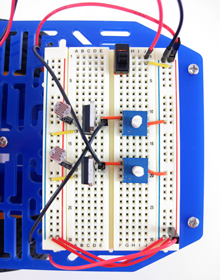 A fully wired breadboard for a light-following robot