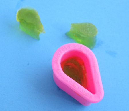 A cookie cutter is used to remeasure the size of jello pieces after soaking in different liquids
