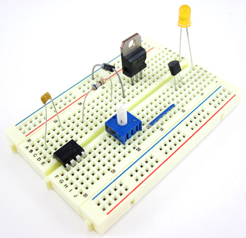 Various electronic components plugged into a half-sized breadboard