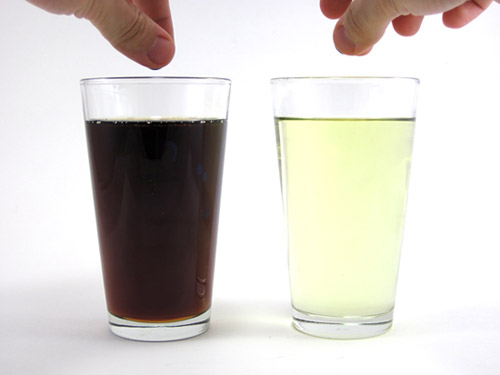 An example race for two marbles. The left glass has maple syrup and the right glass has vegetable oil.