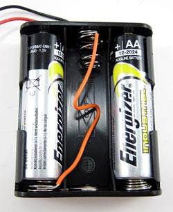 A jumper wire is used to convert a three double A battery pack into a two double A battery pack