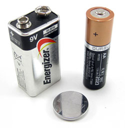 A 9 volt, double A and coin cell battery standing side-by-side