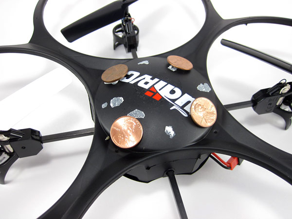 Pennies attached to the frame of a drone with double-sided foam tape