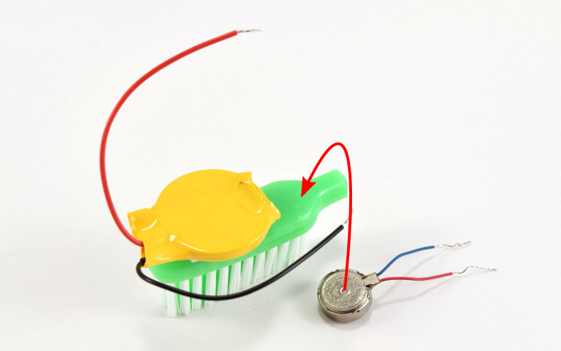 Attach motor to toothbrush.