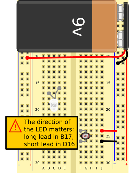 Insert the longer lead of the white LED into hole B17 and the shorter lead in hole D16. Bend the LED so it points sideways, away from the battery.