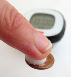 The time a lip balm sample with a penny can stick to your finger is a measure of the stickiness of the lip balm.