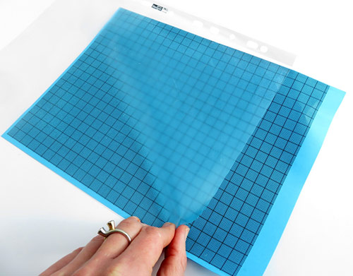 Protect a sheet of millimeter graph paper.