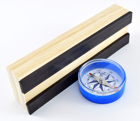 Compass pointing at magnetic strip