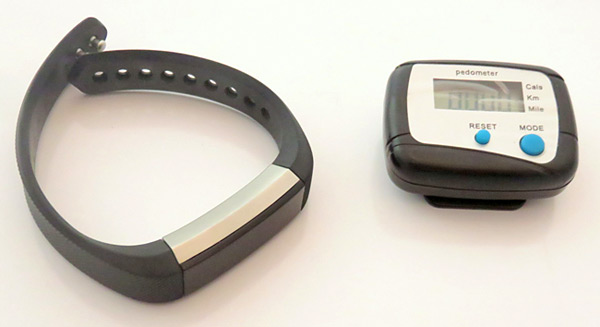 An activity tracker and a pedometer both display the distance walked.