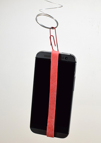 phone with google's science journal hanging from a spring