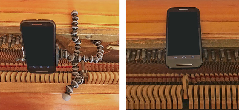 Smartphone is placed above the hammers within a piano