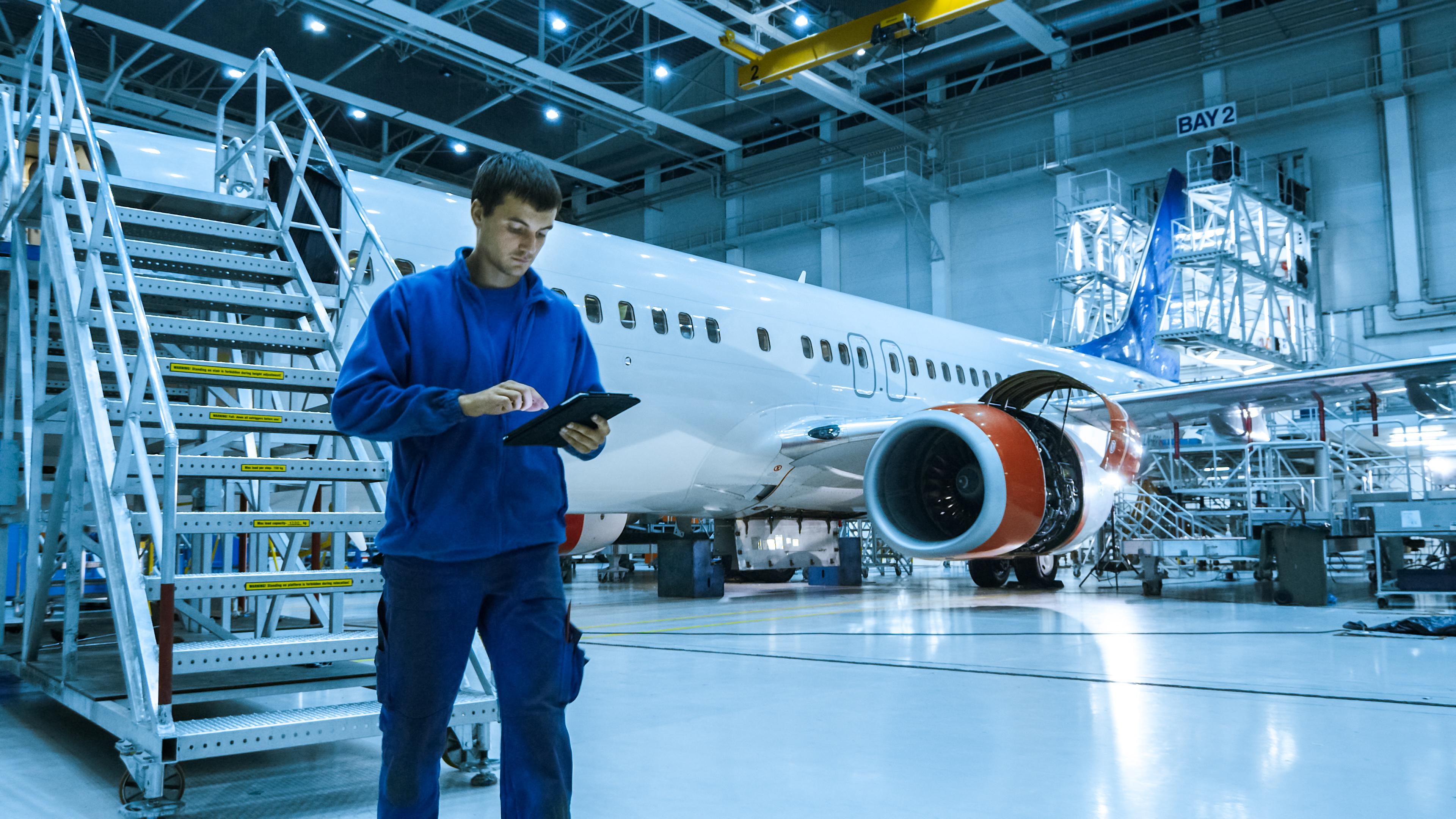 aviation inspector looking at landing gear