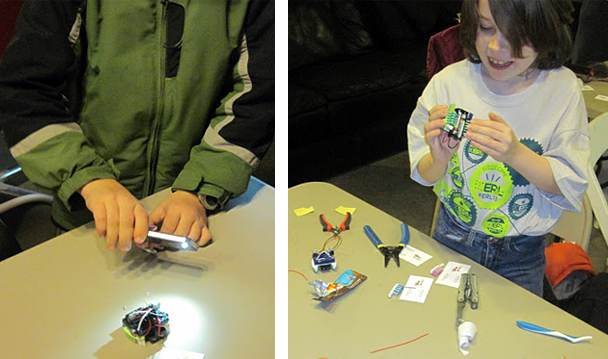 Students working on light-sensing bristlebot robotics project