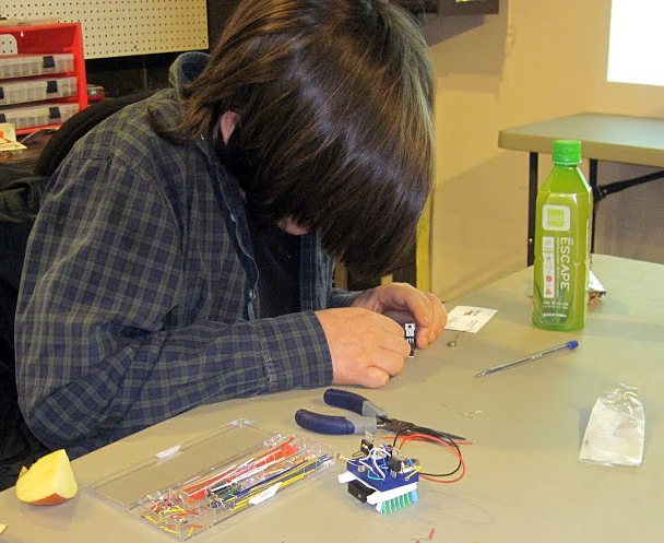 Student working on light-sensing bristlebot robotics project