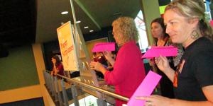 Teachers do paper airplane folding activity